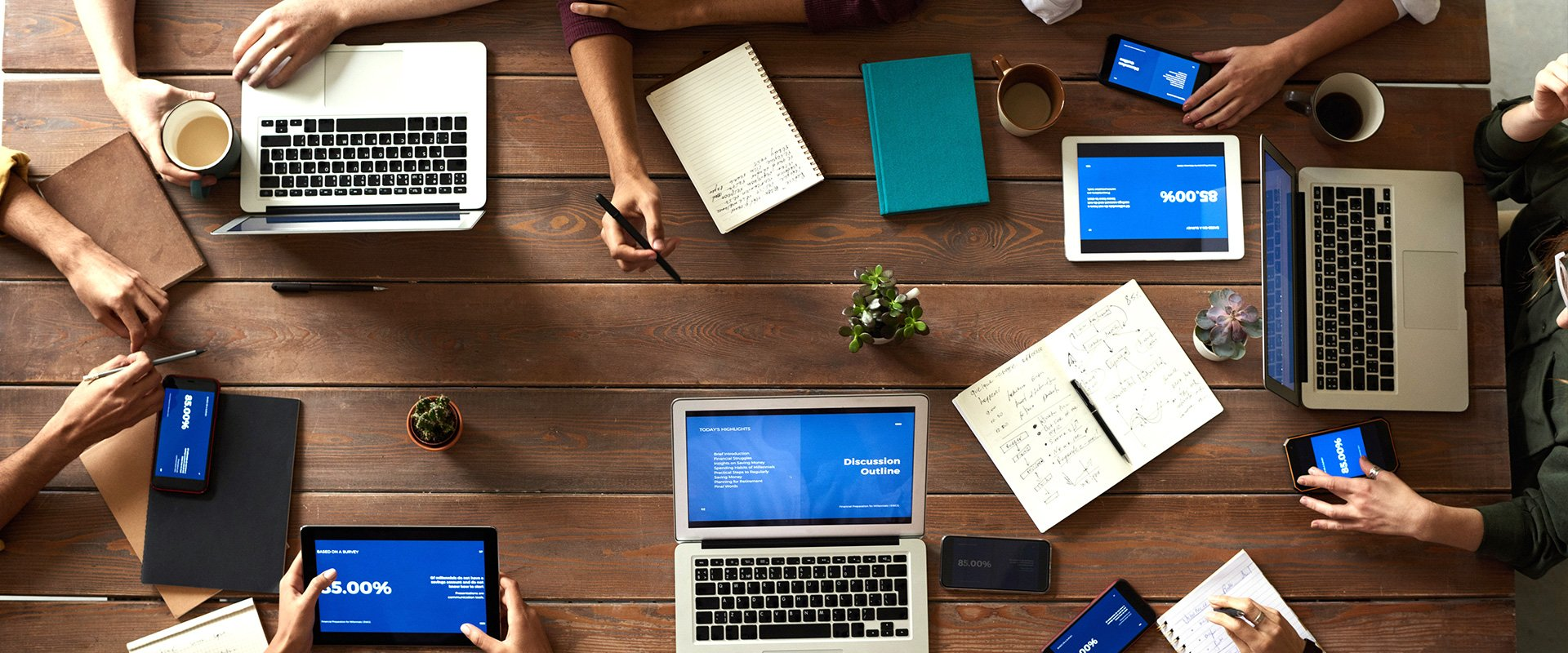 Meeting at a table with multiple devices