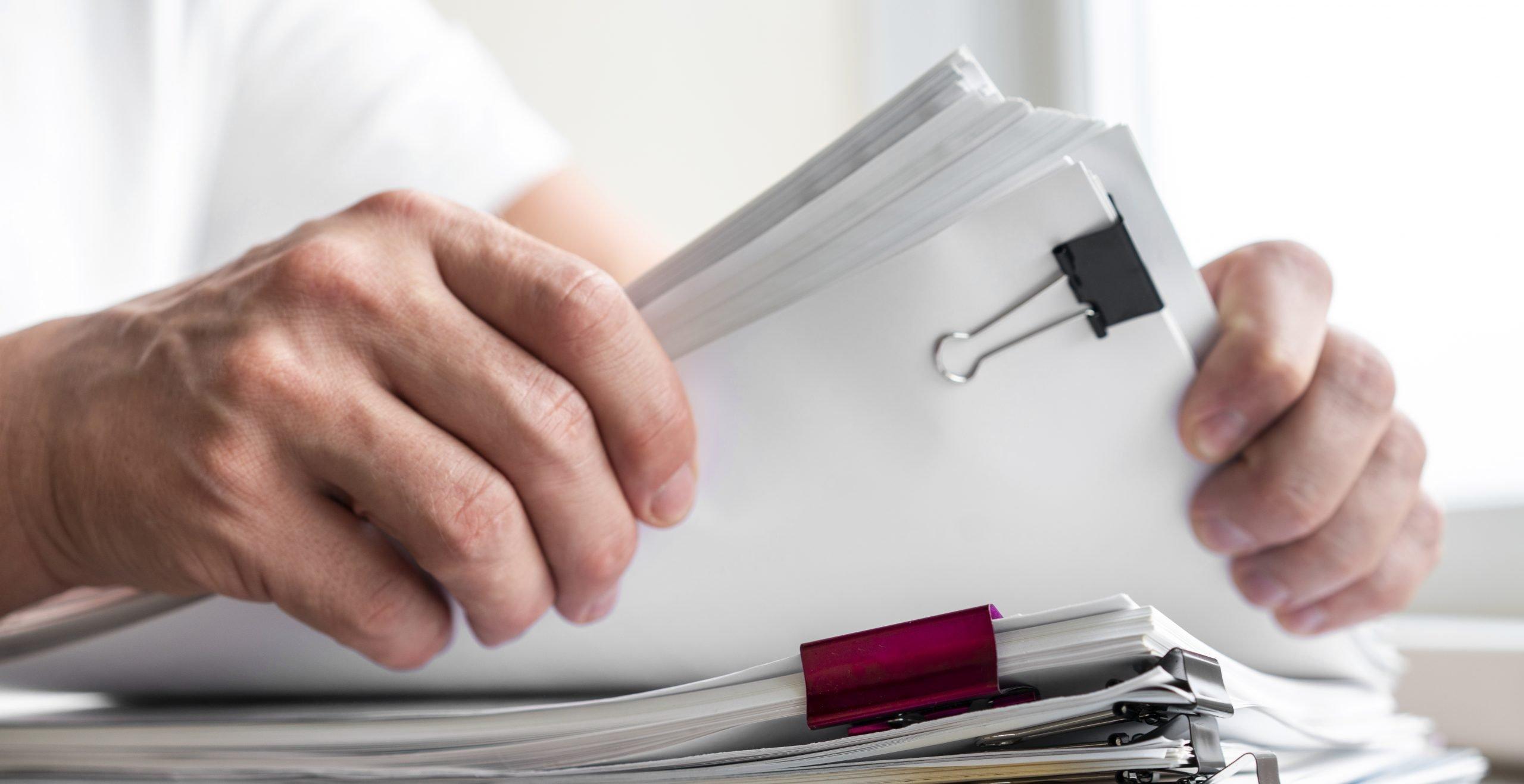 man holding files